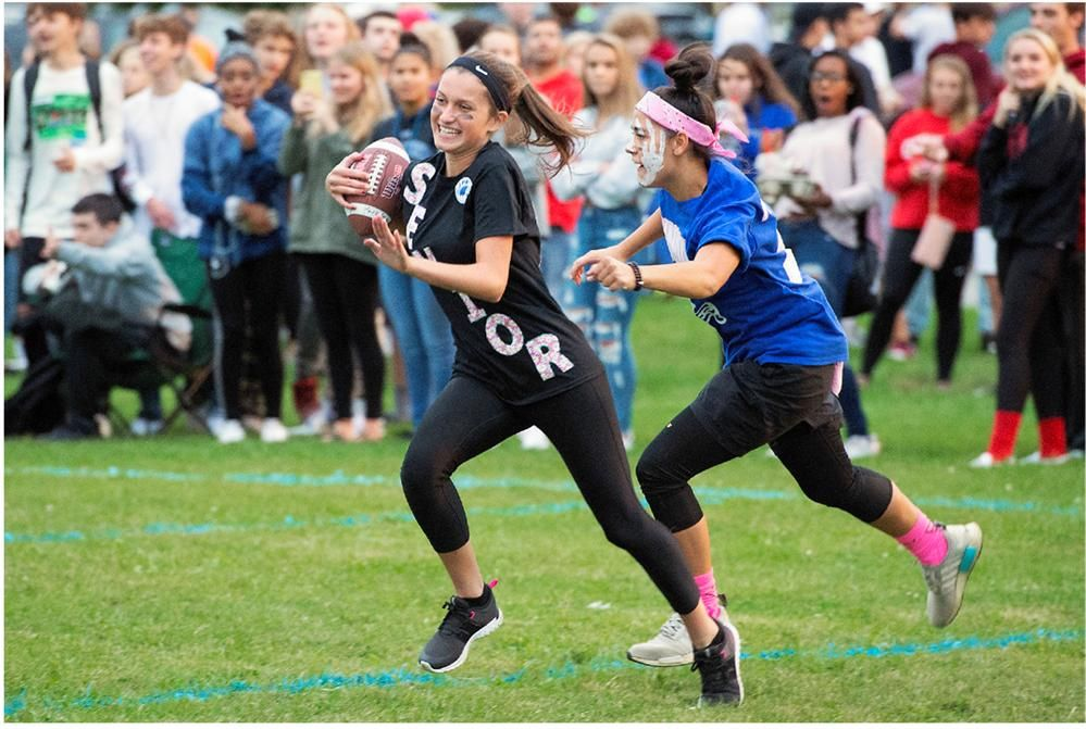 Hannah Gorski runs with the ball after catching an interception during the Powder Puff Football game