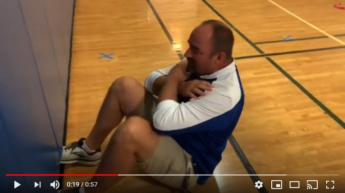 PE teacher does a situp.