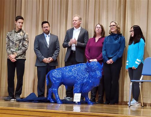 Officials unveil the blue buffalo.